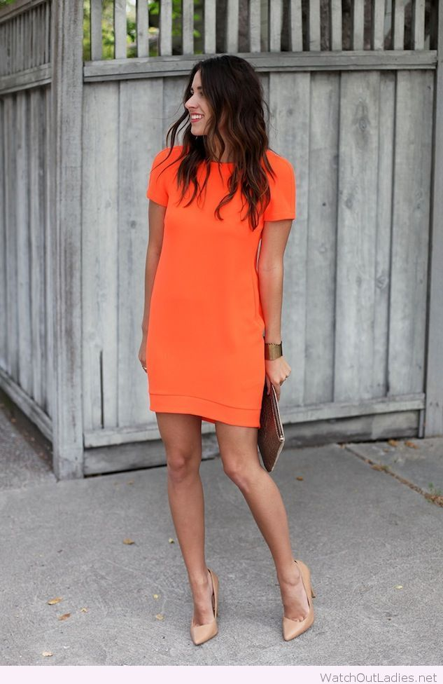 Bright orange dress and nude accessories