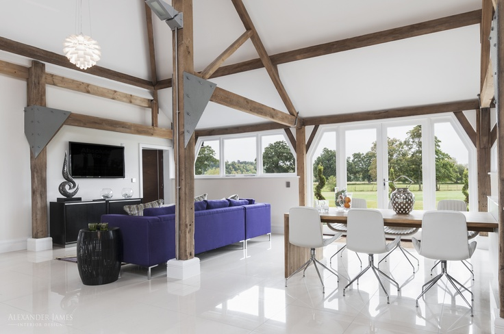 The barn's design allows natural light to flow into the house, creating a fantastic living area. #interiors #design