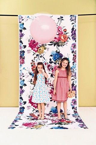 Suspend floral fabric from a pole to create a lively space for a pretty and professional photo shoot