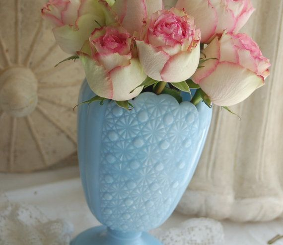 """The vase stands 9"""" tall and the opening is 4"""" by 3 1/2"""" wide."""