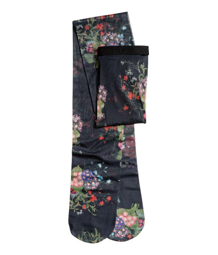 Svart/Blommig. ERDEM x H&M. Ett par strumpbyxor med tryckt blommönster. Resår i midjan. 40 denier.
