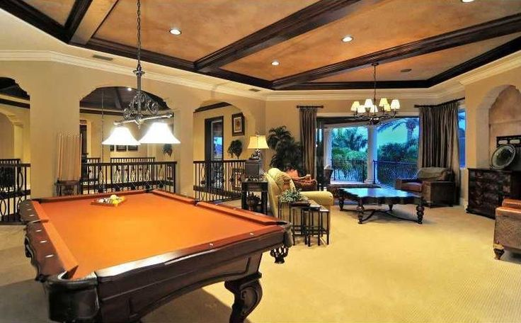 Craftsman Game Room with Pendant Light, Crown molding, Exposed beam, Carpet