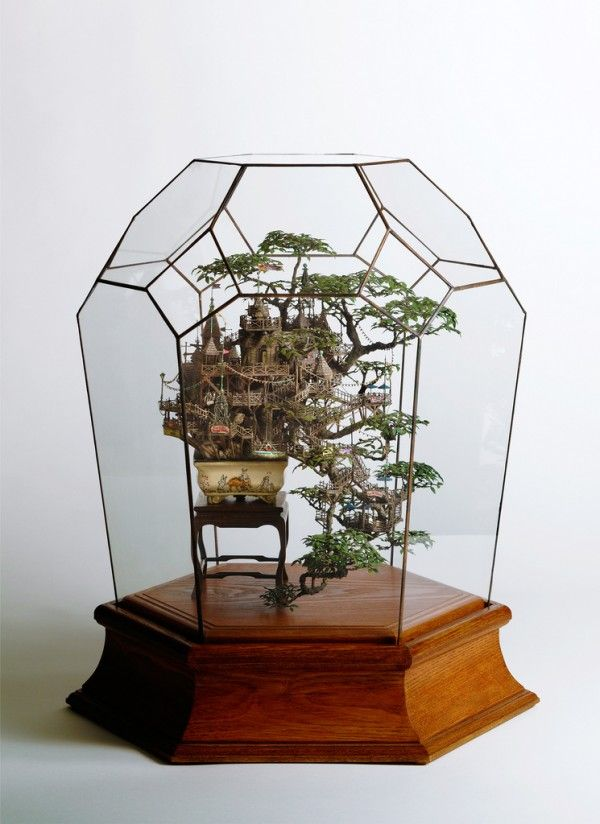 Using craft paper, plastic, plaster, acrylic resin, paint and other materials, Takanori Aiba constructs sprawling miniature communities that wrap around bonsai trees, lighthouses, and amongst the cliffs of nearly vertical islands.