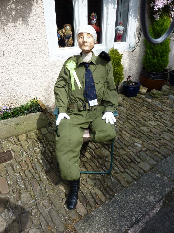 A war hero sits out in the sun.