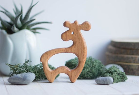 A wooden teether (fox, deer or squirrel) made of beech and covered with linseed oil is the ideal first toy for babies to grasp and chew. Sanded perfectly smooth. A unique gift for new parents and their new little ones. The price is given for one teether. MATERIALS: beech SIZE: 9 cm х 7 cm