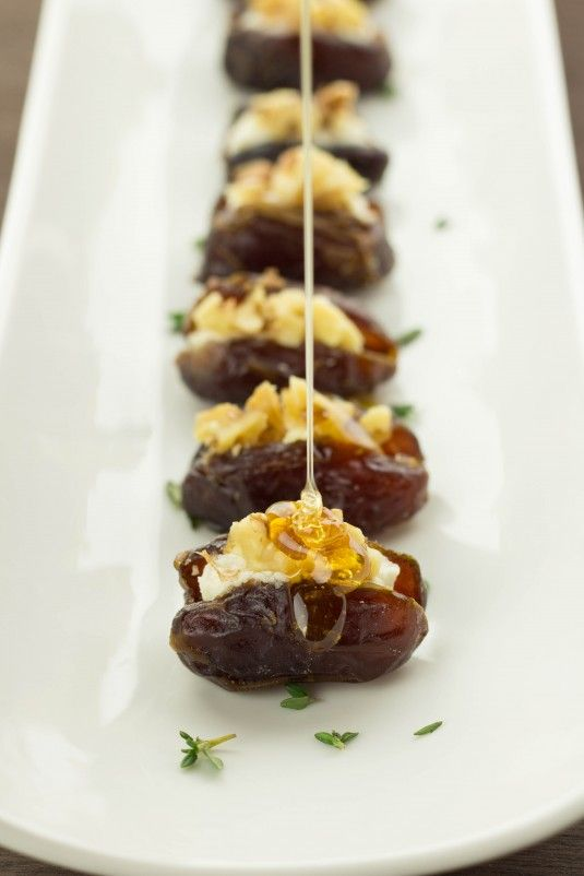 Honey Goat Cheese Dates with Walnuts-- Wow! Soo rich and delicious. Didn't have thyme on hand and used regular goat cheese. I used half a date per so didn't present as neat as pic but tastes even more mouthwatering than it looks!