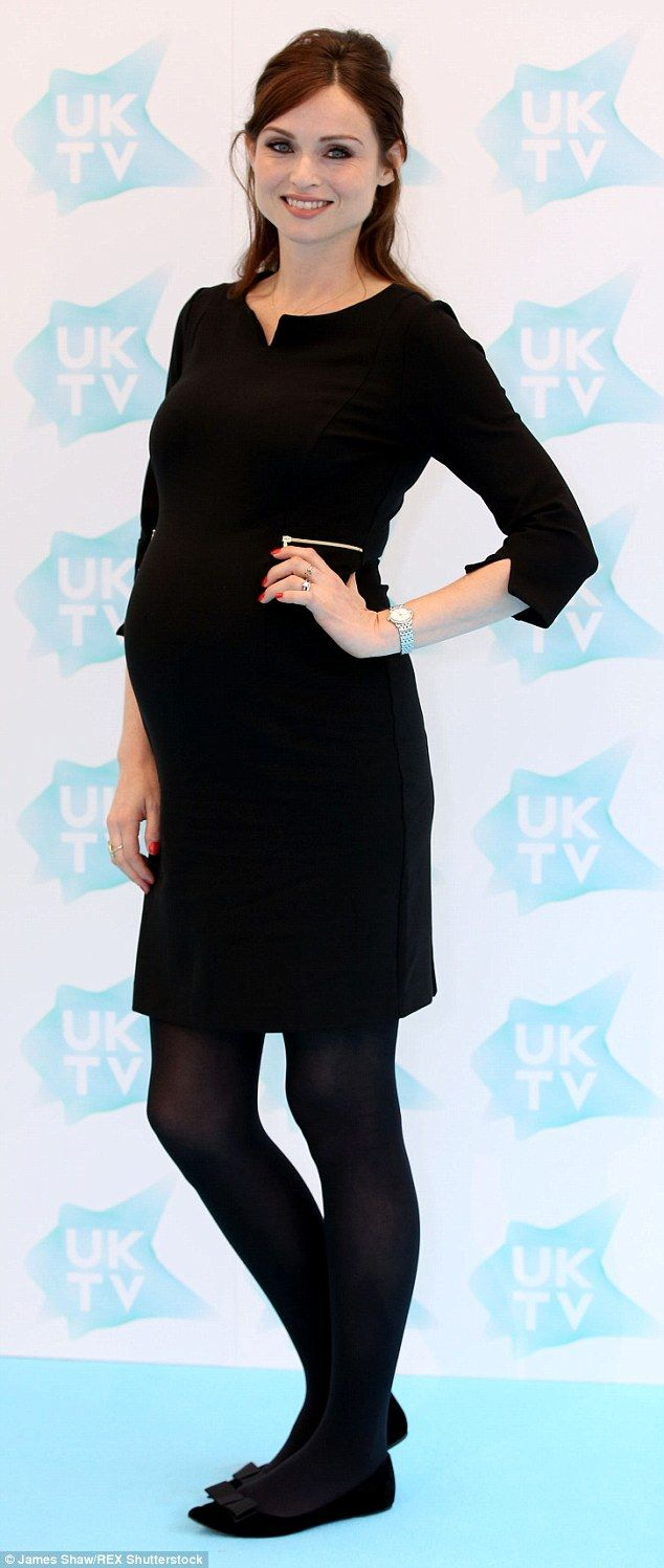 Changing shape: Wearing a classic black dress with three quarter length sleeves, Sophie op...