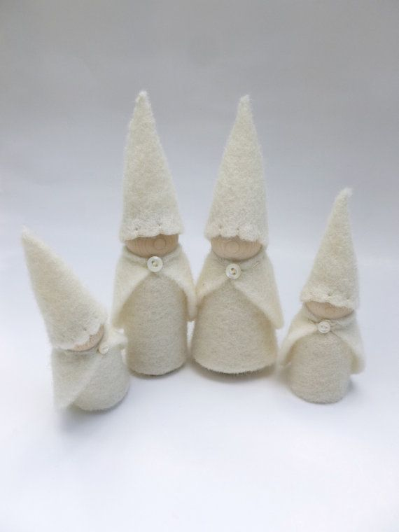 A family of wood gnomes all dressed up in their winter outfits. Clothing has been made from handmade wool felt. Gnomes measure 3 1/1 and 2 1/2