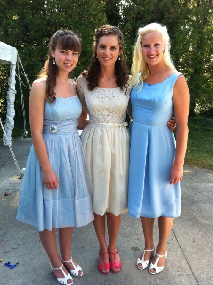 Bride Katelyn (middle) wearing her going-away dress with her bridesmaids in blue -- all 1950s dresses.