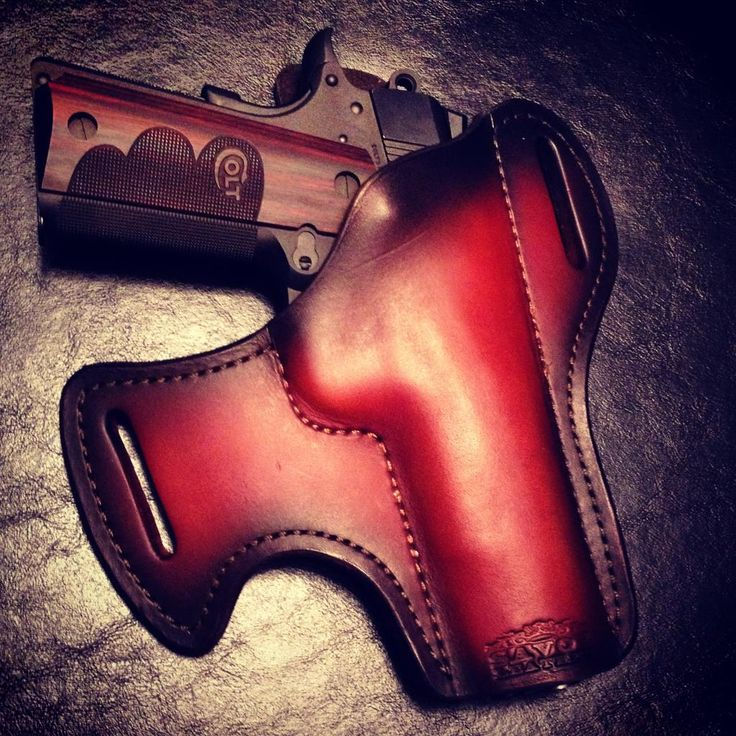 This picture hits me right where I live. That rich, red leather. That sleek, deadly pistol.