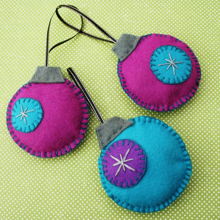 https://flic.kr/p/8zLysb | Trio of baubles | A gorgeous, funky, & bright set of 3 handsewn felt baubles.   Based on one of my many festive doodles, all pieces are handcut and sewn together.   Each bauble measures approx 3 inches round and features a retro-style embroidered snow-flake design.   You will receive the 3 baubles as shown in the pictures here: 2 magenta and 1 teal. Each has a ribbon loop sewn in ready for you to hang on your tree!