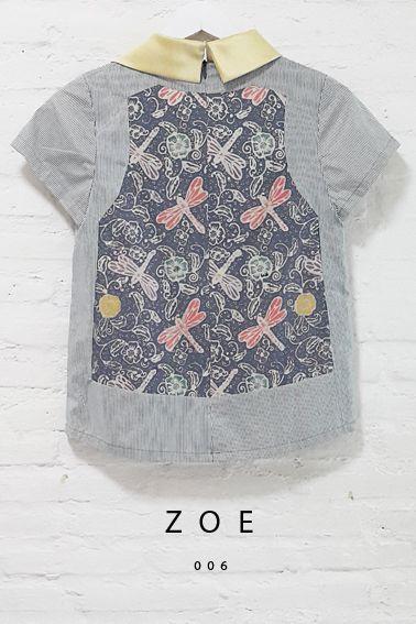 Zoe 006 IDR 420.000 Asymmetric Semi-Satin Collar Contemporary Batik with Stripe Blouse  Length of Blouse : approx. 59.5 cm.  Material Used : Batik Cap Contemporary, Cotton / Stripe Fabric, Cotton  Standard Zipper Length (50-55cm) at the back
