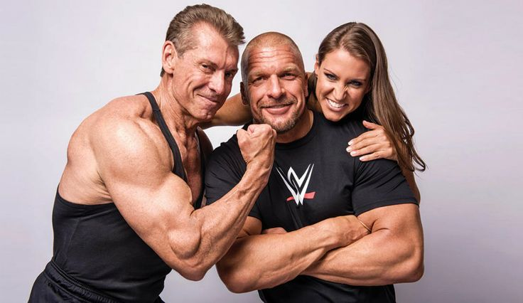 Vince mcmahon , triple h and stephanie mcmahon for muscle fitness photo shoot