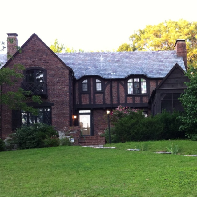 tudor style home with two story flagstone turret entry pasadena