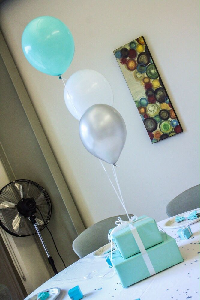 Centerpiece Ideas from my Baby's welcoming party..Used shipping boxes of two different sizes and used wrapping paper and ribbons to cover them up..then hang some balloons It was a tiffany and co theme but you can pick your own colors #babyshower #tiffany and co #centerpiece