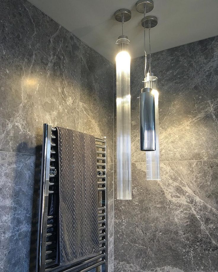 This stunning Portsea Grey Marble bathroom features oversized tiles for dramatic effect. Design by @bagnatoarchitects #cdkstone #portseagrey #marble #naturesmasterpiece #naturalstone #lovestone #lithofin #designinspiration #bathroominspiration #floorin