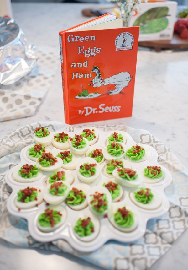 Green Eggs and Ham is a fun and classic children's book! Instead of scrambled eggs, make deviled eggs with a touch of green food coloring and sprinkled bacon on the top. | Alyssa Renee Photography