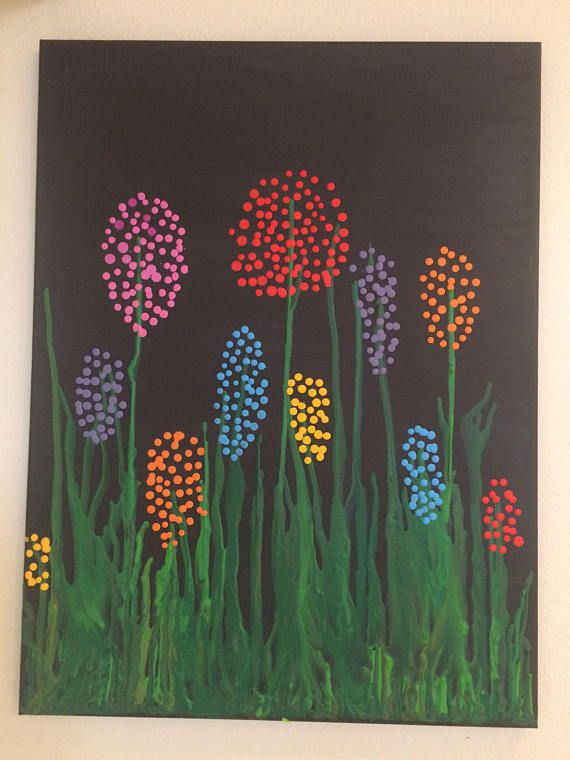 28x24 canvas with acrylic background and melted crayons forming gras and flowers