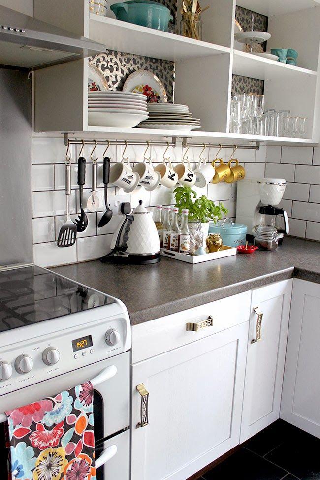 open shelves, hanging utensils & mugs, concrete counters