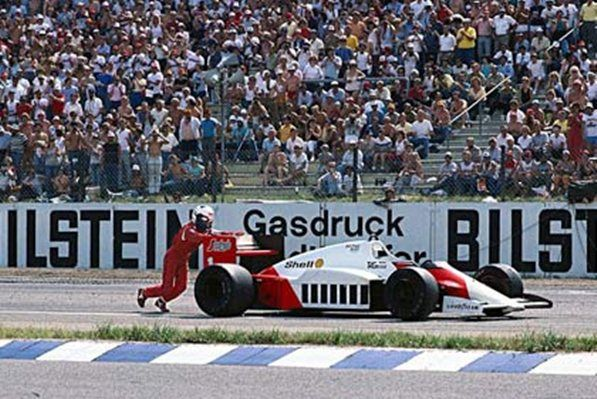 Hockenheim, July 1986: Alain Prost pushes his McLaren towards the finish line after running out of fuel on the penultimate lap of the German Grand Prix. He was classified sixth. © Schlegelmilch