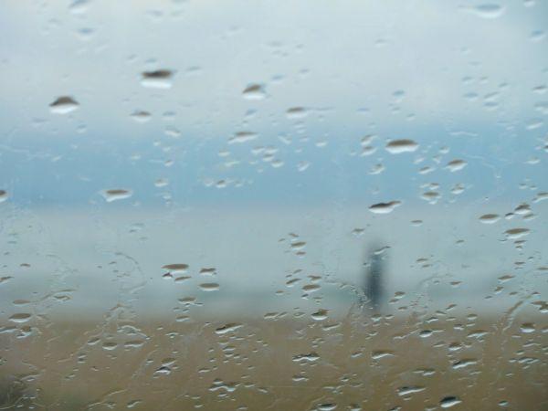 Walking in the rain by the seaside