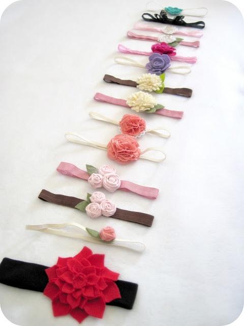 Lots of flower headband tutorials:  the purl bee - felt rose barrette, little miss momma - scrunch fabric flower pom pom tutorial, little birdie secrets - fabric rosebud tutorial, not martha (on holidash) - felt dahlia, i am momma - hear me roar - rolled felt flower
