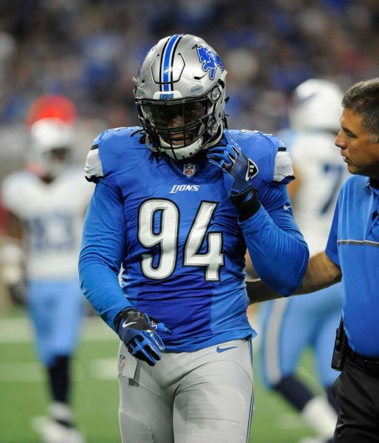 Detroit Lions defensive end Ezekiel Ansah (94) is escorted off the field during the first half of an NFL football game against the Tennessee Titans, Sunday, Sept. 18, 2016, in Detroit.