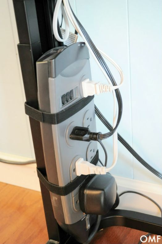 Attach power strip to desk leg with velcro strips to keep loose cords at bay.  Great idea!