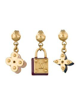 Gold-tone Louis Vuitton Monogram earrings set with multicolor enamel accents and clutch backs. Includes three interchangeable earrings $319