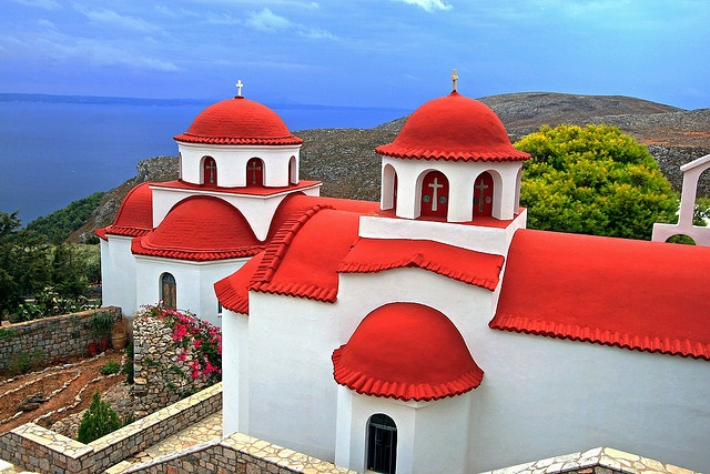 Red-roofed monastery of Agios Savvas overlooking the blue sea. #trinaturk