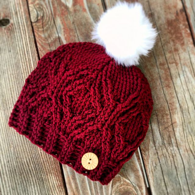 This hat has a Messy Bun Hat option and a regular slouchy hat option too. They call for different yarn weights; you will need light worsted weight yarn for the slouchy hat or a thicker worsted weight yarn for the messy bun option. Dress it up with diamonds and you have a trendy sparkly hat!