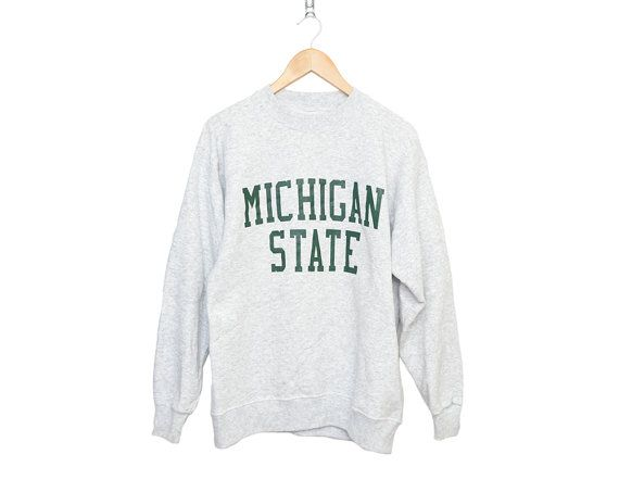 Nice vintage Michigan State sweatshirt. Very soft and shows no signs of wear.    Size: L    All measurements taken with garment laid flat.    Chest: 22