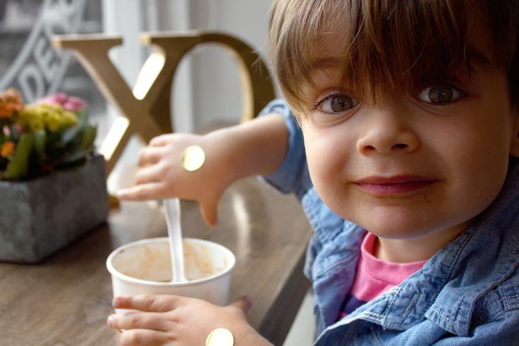River enjoying the last bites of his Soft Serve vegan Ice Cream at Kelly's Bake Shoppe