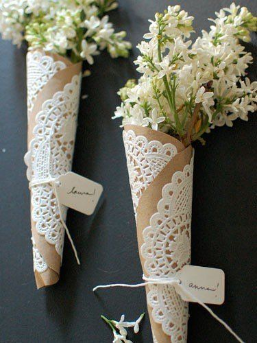 Cute DIY cone for holding flowers or other things: glue paper doilies to cut out Kraft paper, roll, tie with twine