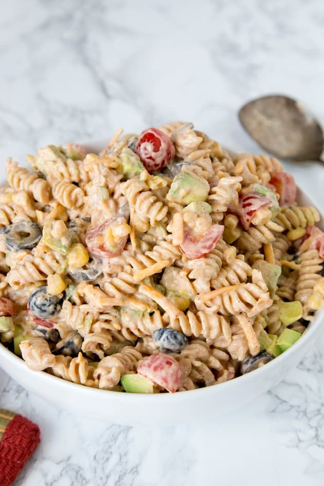 Taco Pasta Salad is a great make ahead dish for your summer barbecues and potlucks. This one'll disappear fast!