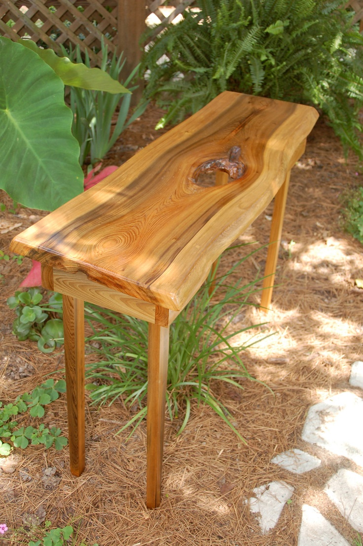 "Unique table crafted from a 16' 600 year old ""Sinker Cypress"" hollow log that was recovered by the craftsman from the bottom of the Waccamaw River in South Carolina, sawn into lumber, dried and finally created this unique piece with a very detailed history behind it. The Cypress tree was cut from The Little Pee Dee River swamp in the 1890's and sank on it's way to the sawmill downstream and laid submerged for 115 years."