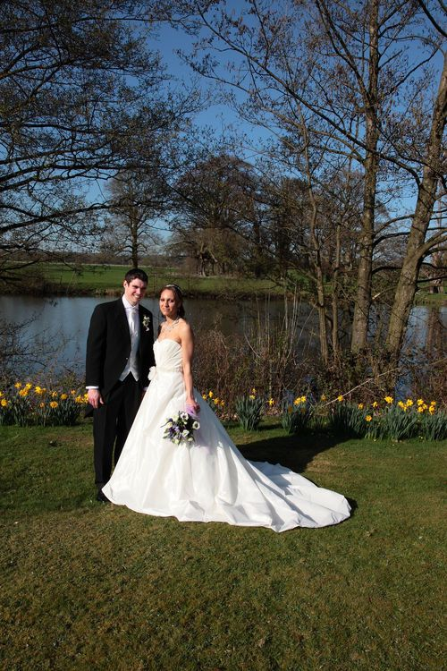 Bride and groom with lake in background
