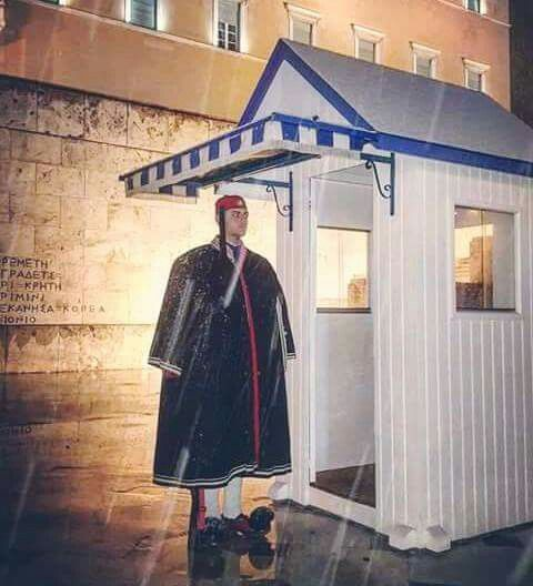 Greek Presidential Guard (Evzonas) wearing the winter traditional uniform at the Tomb of the Unknown Soldier, in front of the Hellenic Parliament at the Syntagma Square, Athens, Greece
