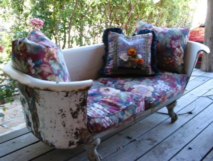 Bathtub sofa: repurposed old claw foot bath tub made into a porch seating area