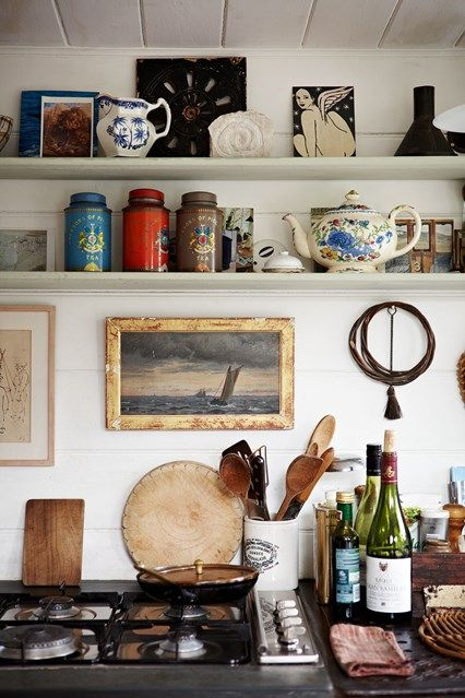 Charming open shelves kitchen with bits of Parisian chic style