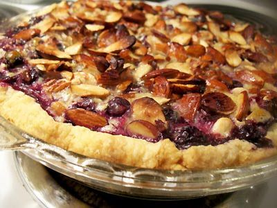 Blueberry goat cheese pie with a hint of fresh basil and a slice almond topping