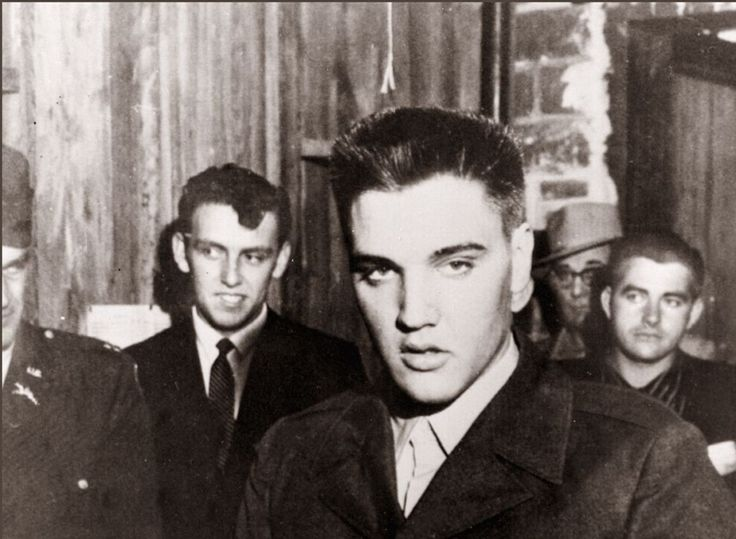 FORT CHAFFEE, UNITED STATES: Rock'n roll legend Elvis Presley in file picture dated 26 March 1958 in Fort Chaffee at the beginning of his military service. Elvis spent 17 months in Friedberg, Germany, between October 1958 and March 1960 as a GI. Elvis Aaron Presley was born 08 January 1935 in Tupelo, Mississippi and was found dead 16 August 1977 from a drug-induced heart attack in his bathroom at Graceland, a colonial estate in Memphis, Tennessee. (Photo credit should read AFP/AFP/Getty…