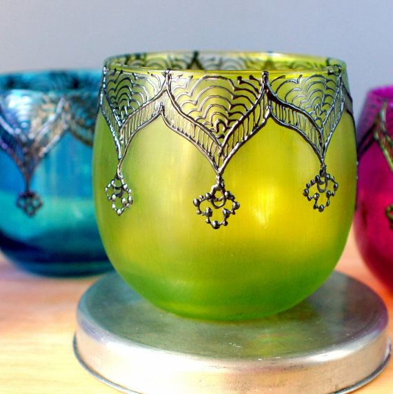 Aren't these pretty?  I can see a row of these on a shelf, burning softly scented candles.  Moroccan Votive Holder with Canary Yellow Glass and by LITdecor, $10.00