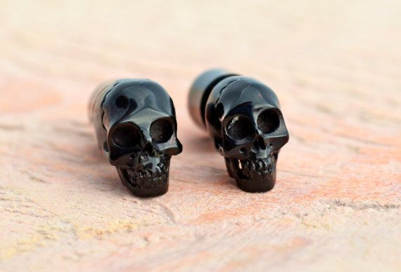 Hey, I found this really awesome Etsy listing at https://www.etsy.com/listing/129665289/carved-skull-black-horn-fake-plugs