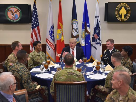 President Trump has lunch with troops during a visit
