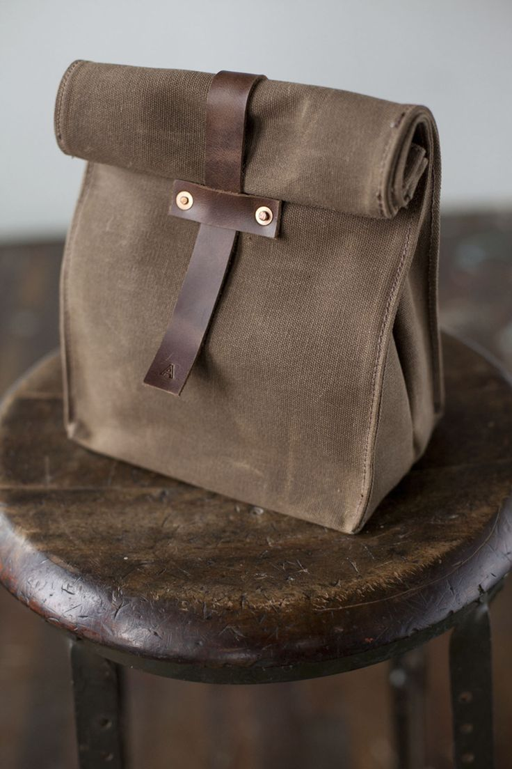 "Be the talk of the office when you bring your lunch in this sturdy, ecological, waxed canvas lunch tote. ""It's a simple, elegant design."" The New York Times ""...comes with a hell of a lot more craftsm"