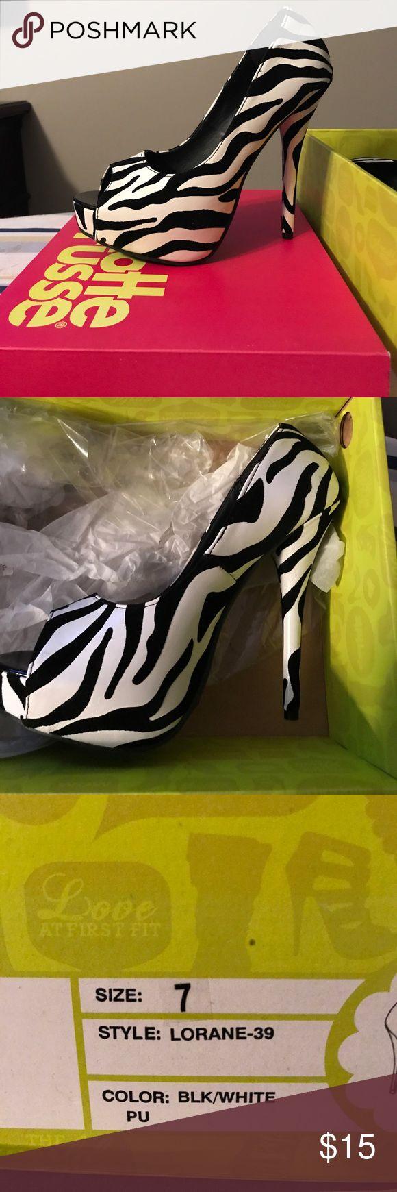 Zebra print pumps Brand new in box Charlotte Rousse zebra print pumps. Charlotte Russe Shoes Heels