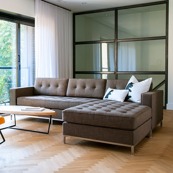 Grey Upholstered Tufted Sectional Sofa With Chrome Metal Legs Plus Oval Wooden Table On Laminated Floor Modern Sofas Leather