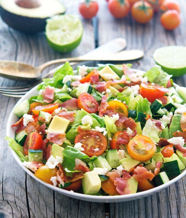 Chopped BLT Salad - romaine lettuce, avocado, cherry tomatoes, bacon, cucumber, crumbled feta, olive oil (would reduce/omit), lime, salt, pepper