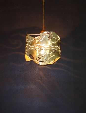 Handmade pendant lamp made of brass.